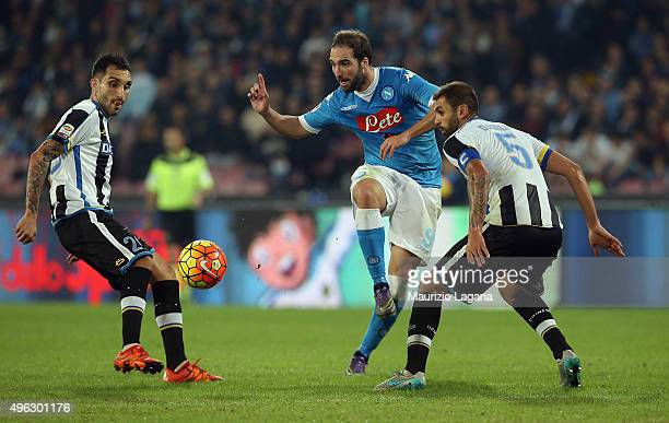 Gonzalo Higuain of Napoli competes for the ball with Francesco Lodi and Danilo of Udinese during the Serie A match between SSC Napoli and Udinese...