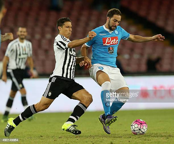 Gonzalo Higuain of Napoli competes for the ball with Hernanes of Juventus during the Serie A match between SSC Napoli and Juventus FC at Stadio San...