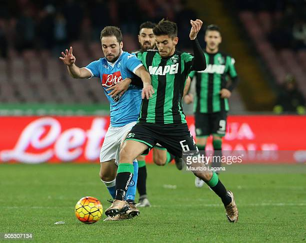 Gonzalo Higuain of Napoli competes for the ball with Lorenzo Pellegrini of Sassuolo during the Serie A match between SSC Napoli and US Sassuolo...