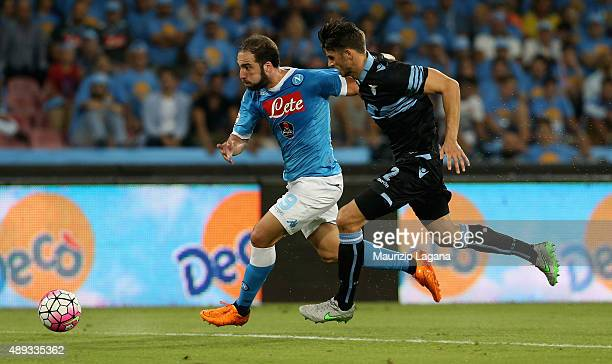 Gonzalo Higuain of Napoli competes for the ball with Wesley Hoedt of Lazio during the Serie A match between SSC Napoli and SS Lazio at Stadio San...