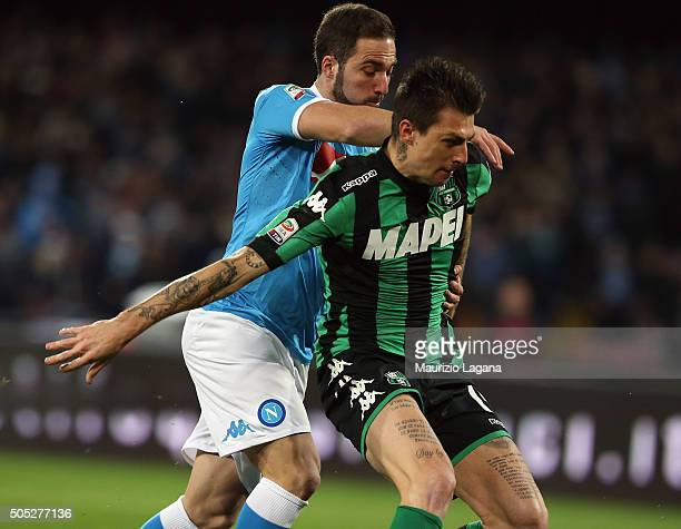 Gonzalo Higuain of Napoli competes with Francesco Acerbi of Sassuolo during the Serie A match between SSC Napoli and US Sassuolo Calcio at Stadio San...