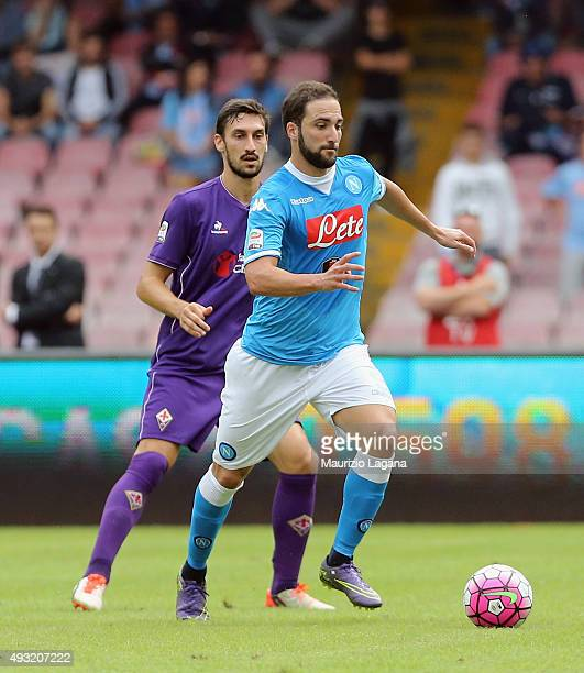 Gonzalo Higuain of Napoli is challenged by Davide Astori of Fiorentina during the Serie A match between SSC Napoli and ACF Fiorentina at Stadio San...