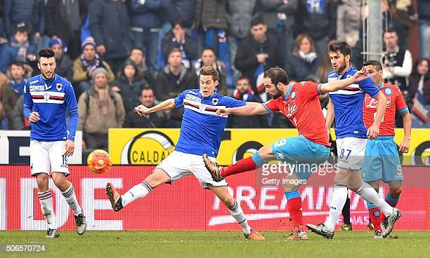 Gonzalo Higuain of Napoli is challenged by Niklas Moisander of Sampdoria during the Serie A match between UC Sampdoria and SSC Napoli at Stadio Luigi...