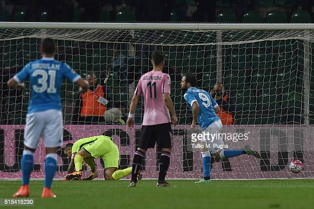 Gonzalo Higuain of Napoli scores a penalty during the Serie A match between US Citta di Palermo and SSC Napoli at Stadio Renzo Barbera on March 13...