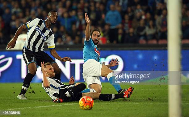 Gonzalo Higuain of Napoli scores his team's opening goal during the Serie A match between SSC Napoli and Udinese Calcio at Stadio San Paolo on...