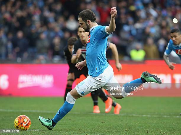 Gonzalo Higuain of Napoli scores his team's opening goal with penalty during the Serie A match between SSC Napoli and Carpi FC at Stadio San Paolo on...