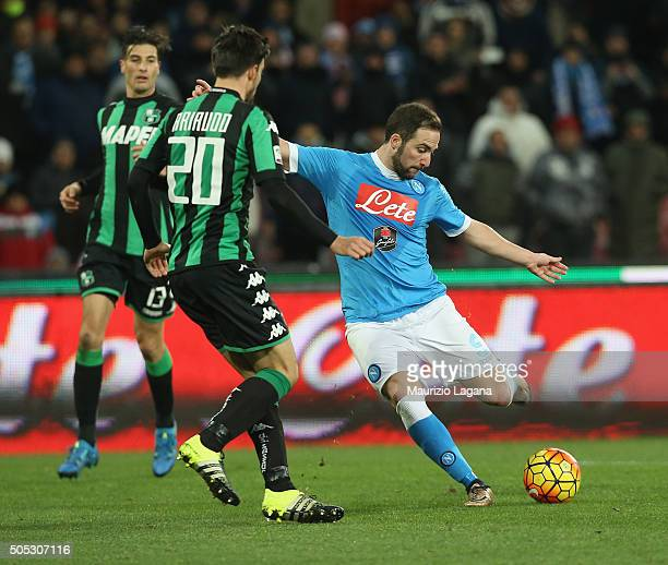 Gonzalo Higuain of Napoli scores his team's third goal during the Serie A match between SSC Napoli and US Sassuolo Calcio at Stadio San Paolo on...