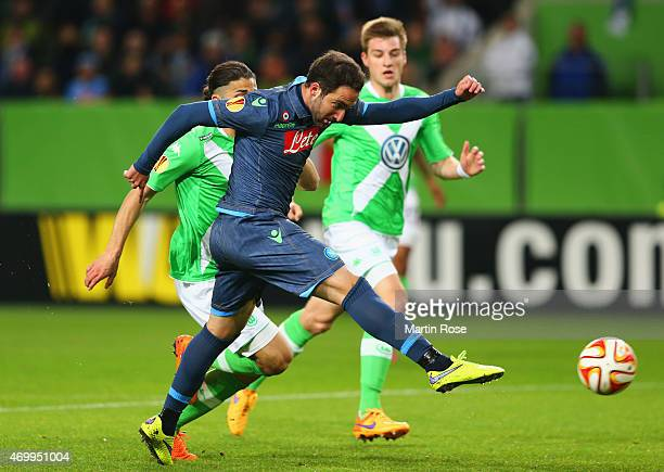 Gonzalo Higuain of Napoli scores their first goal during the UEFA Europa League Quarter Final first leg match between VfL Wolfsburg and SSC Napoli at...