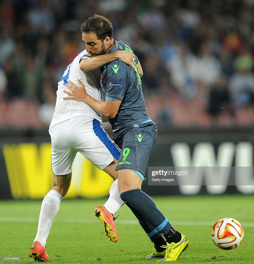 <a gi-track='captionPersonalityLinkClicked' href=/galleries/search?phrase=Gonzalo+Higuain&family=editorial&specificpeople=651523 ng-click='$event.stopPropagation()'>Gonzalo Higuain</a> of Napoli vies with <a gi-track='captionPersonalityLinkClicked' href=/galleries/search?phrase=Yevhen+Cheberyachko&family=editorial&specificpeople=8042109 ng-click='$event.stopPropagation()'>Yevhen Cheberyachko</a> of FC Dnipro Dnipropetrovsk during the UEFA Europa League Semi Final between SSC Napoli and FC Dnipro Dnipropetrovsk on May 7, 2015 in Naples, Italy.