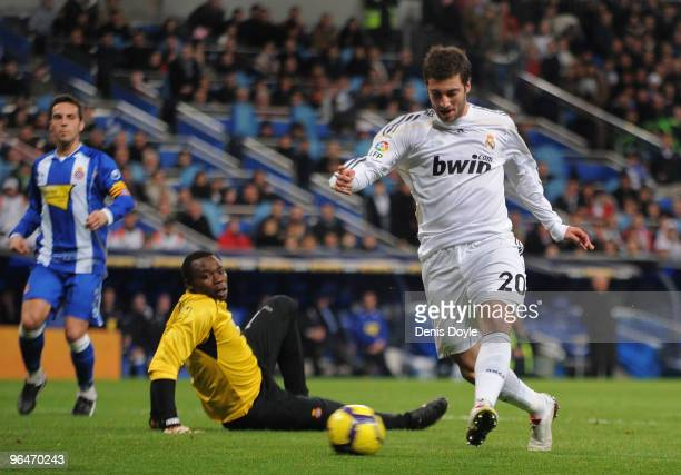 Gonzalo Higuain of Real Madrid beats Espanyol's goalkeeperCarlos Kameni to score Real's third goal during the La Liga match between Real Madrid and...