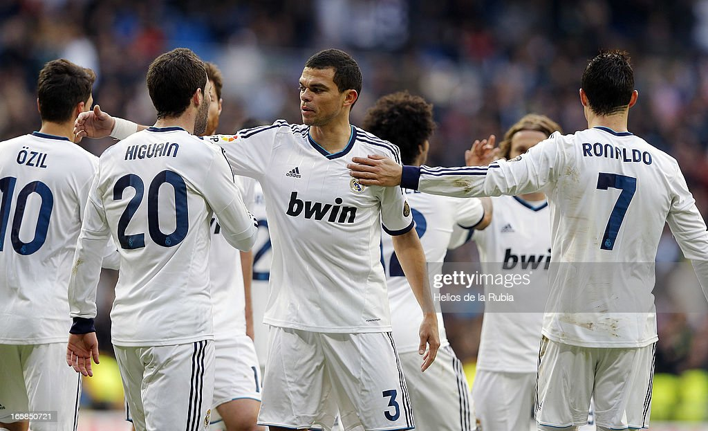 Gonzalo Higuain (L) of Real Madrid celebrate after scoring with team mate Pepe during the La Liga match between Real Madrid and Levante at Estadio Santiago Bernabeu on April 6, 2013 in Madrid, Spain.