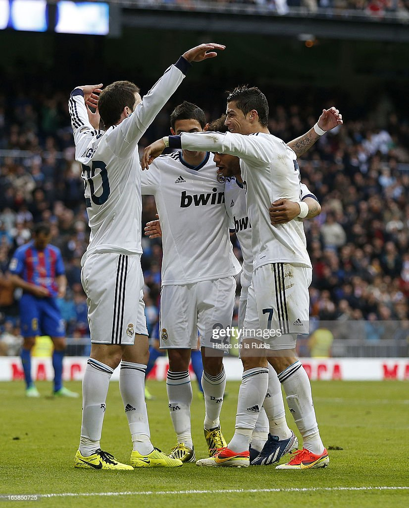 <a gi-track='captionPersonalityLinkClicked' href=/galleries/search?phrase=Gonzalo+Higuain&family=editorial&specificpeople=651523 ng-click='$event.stopPropagation()'>Gonzalo Higuain</a> (L) of Real Madrid celebrate after scoring with team mate <a gi-track='captionPersonalityLinkClicked' href=/galleries/search?phrase=Angel+Di+Maria&family=editorial&specificpeople=4110691 ng-click='$event.stopPropagation()'>Angel Di Maria</a> (C) and <a gi-track='captionPersonalityLinkClicked' href=/galleries/search?phrase=Cristiano+Ronaldo+-+Soccer+Player&family=editorial&specificpeople=162689 ng-click='$event.stopPropagation()'>Cristiano Ronaldo</a> during the La Liga match between Real Madrid and Levante at Estadio Santiago Bernabeu on April 6, 2013 in Madrid, Spain.