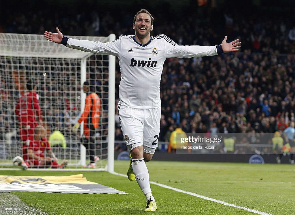 <a gi-track='captionPersonalityLinkClicked' href=/galleries/search?phrase=Gonzalo+Higuain&family=editorial&specificpeople=651523 ng-click='$event.stopPropagation()'>Gonzalo Higuain</a> of Real Madrid celebrates after scoring during the La Liga match between Real Madrid and RCD Mallorca at Estadio Santiago Bernabeu on March 16, 2013 in Madrid, Spain.