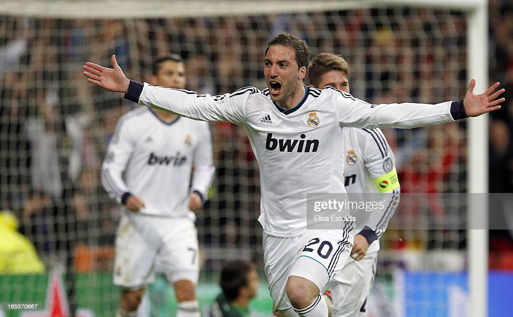 <a gi-track='captionPersonalityLinkClicked' href=/galleries/search?phrase=Gonzalo+Higuain&family=editorial&specificpeople=651523 ng-click='$event.stopPropagation()'>Gonzalo Higuain</a> of Real Madrid celebrates after scoring during the UEFA Champions League Quarter Final match between Real Madrid and Galatasaray at Estadio Santiago Bernabeu on April 3, 2013 in Madrid, Spain.