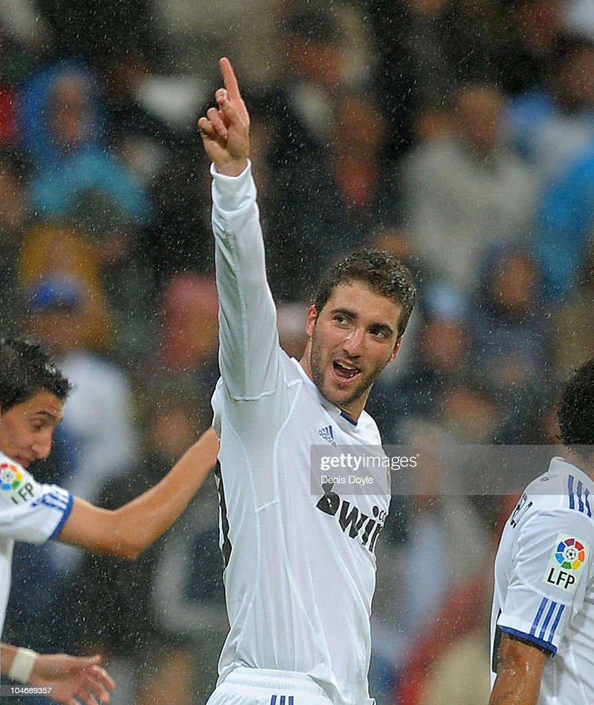 <a gi-track='captionPersonalityLinkClicked' href=/galleries/search?phrase=Gonzalo+Higuain&family=editorial&specificpeople=651523 ng-click='$event.stopPropagation()'>Gonzalo Higuain</a> of Real Madrid celebrates after scoring Real's fourth goal during the La Liga match between Real Madrid and Deportivo La Coruna at Estadio Santiago Bernabeu on October 3, 2010 in Madrid, Spain.