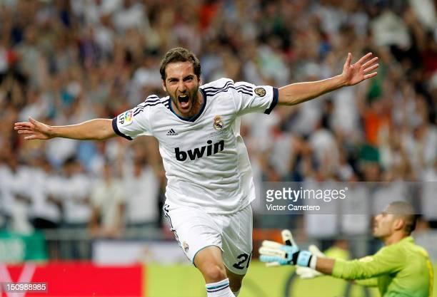 Gonzalo Higuain of Real Madrid celebrates after scoring the opening goal during the Supercopa second leg match between Real Madrid and FC Barcelona...