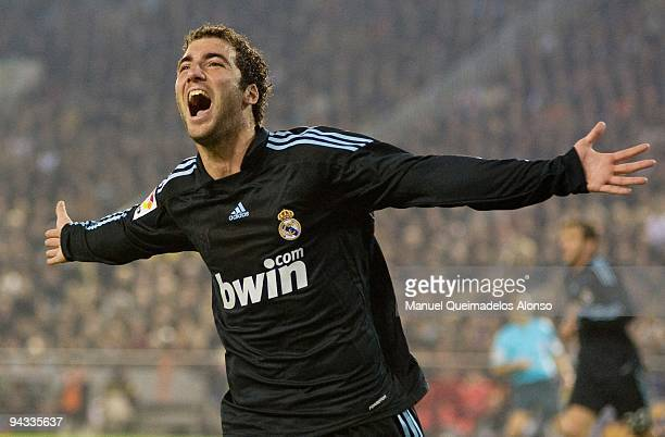 Gonzalo Higuain of Real Madrid celebrates scoring the second goal during the La Liga Match between Valencia and Real Madrid at Estadio Mestalla on...