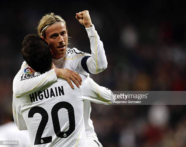 Gonzalo Higuain of Real Madrid celebrates with Guti after scoring during the La Liga match between Real Madrid and Valencia at Estadio Santiago...