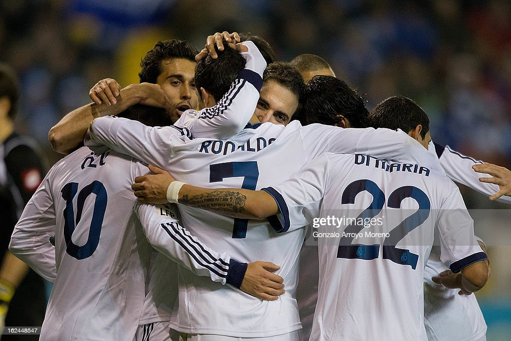 <a gi-track='captionPersonalityLinkClicked' href=/galleries/search?phrase=Gonzalo+Higuain&family=editorial&specificpeople=651523 ng-click='$event.stopPropagation()'>Gonzalo Higuain</a> (3dR) of Real Madrid CF celebrates scoring their second goal with teammates Mezut Ozil (L), <a gi-track='captionPersonalityLinkClicked' href=/galleries/search?phrase=Alvaro+Arbeloa&family=editorial&specificpeople=3941965 ng-click='$event.stopPropagation()'>Alvaro Arbeloa</a> (2ndL), <a gi-track='captionPersonalityLinkClicked' href=/galleries/search?phrase=Cristiano+Ronaldo+-+Soccer+Player&family=editorial&specificpeople=162689 ng-click='$event.stopPropagation()'>Cristiano Ronaldo</a> (3dL) and <a gi-track='captionPersonalityLinkClicked' href=/galleries/search?phrase=Angel+Di+Maria&family=editorial&specificpeople=4110691 ng-click='$event.stopPropagation()'>Angel Di Maria</a> (R) during the La Liga match between RC Deportivo La Coruna and Real Madrid CF at Riazor Stadium on February 23, 2013 in La Coruna, Spain.