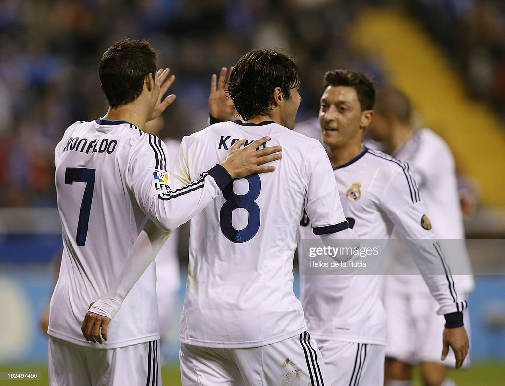 Gonzalo Higuain (3dR) of Real Madrid CF celebrates scoring their second goal with teammates Mezut Ozil (L), Alvaro Arbeloa (2ndL), <a gi-track='captionPersonalityLinkClicked' href=/galleries/search?phrase=Cristiano+Ronaldo+-+Soccer+Player&family=editorial&specificpeople=162689 ng-click='$event.stopPropagation()'>Cristiano Ronaldo</a> (3dL) and <a gi-track='captionPersonalityLinkClicked' href=/galleries/search?phrase=Angel+Di+Maria&family=editorial&specificpeople=4110691 ng-click='$event.stopPropagation()'>Angel Di Maria</a> (R) during the La Liga match between RC Deportivo La Coruna and Real Madrid CF at Riazor Stadium on February 23, 2013 in La Coruna, Spain.
