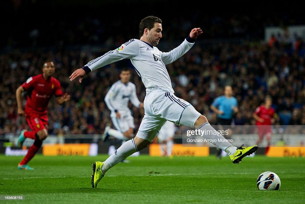 <a gi-track='captionPersonalityLinkClicked' href=/galleries/search?phrase=Gonzalo+Higuain&family=editorial&specificpeople=651523 ng-click='$event.stopPropagation()'>Gonzalo Higuain</a> of Real Madrid CF runs for the ball during the La Liga match between Real Madrid CF and RCD Mallorca at Santiago Bernabeu Stadium on March 16, 2013 in Madrid, Spain.