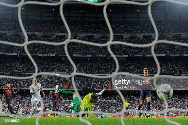 Gonzalo Higuain of Real Madrid CF scores the opening goal during the Super Cup second leg match betwen Real Madrid and FC Barcelona at Estadio...