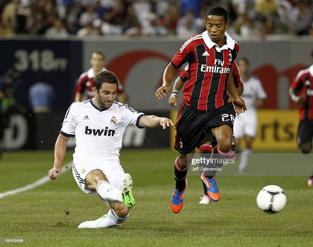 Gonzalo Higuain of Real Madrid clears the ball in front of Urby Emanuelson of AC Milan during their match at Yankee Stadium on August 8 2012 in the...