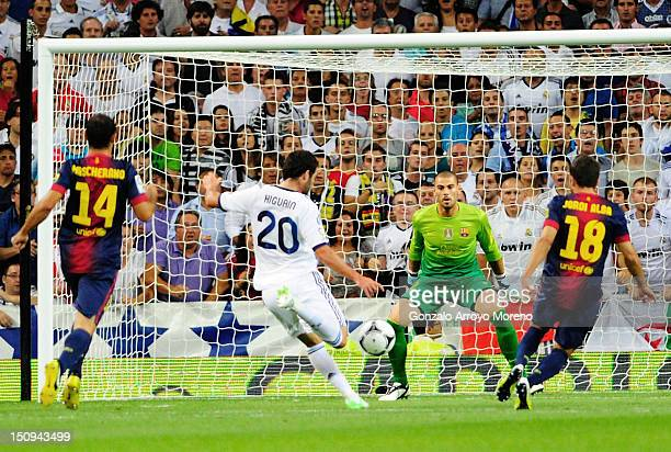 Gonzalo Higuain of Real Madrid scores his first goal during the Supercopa second leg match between Real Madrid and Barcelona at Estadio Santiago...