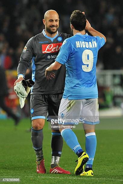 Gonzalo Higuain of SSC Napoli celebrates victory with teammate Jose Manuel Reina at the end of the Serie A match between Torino FC and SSC Napoli at...