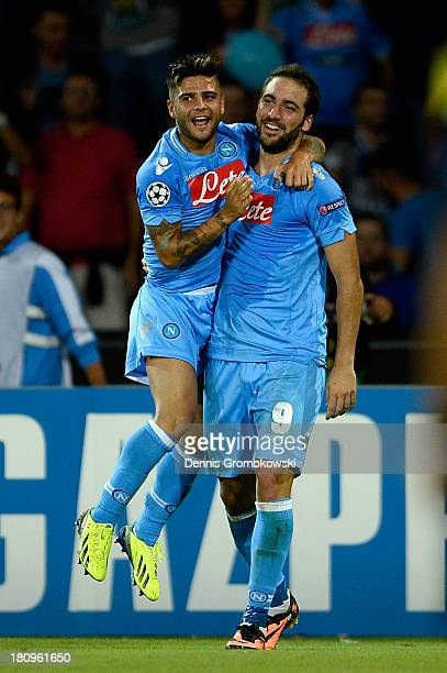 Gonzalo Higuain of SSC Napoli celebrates with teammate Lorenzo Insigne after heading his team's first goal during the UEFA Champions League Group F...