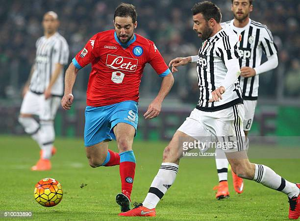 Gonzalo Higuain of SSC Napoli competes for the ball with Andrea Barzagli of Juventus FC during the Serie A match between and Juventus FC and SSC...