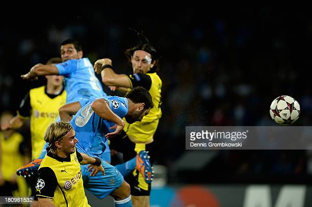 Gonzalo Higuain of SSC Napoli heads his team's first goal during the UEFA Champions League Group F match between SSC Napoli and Borussia Dortmund at...