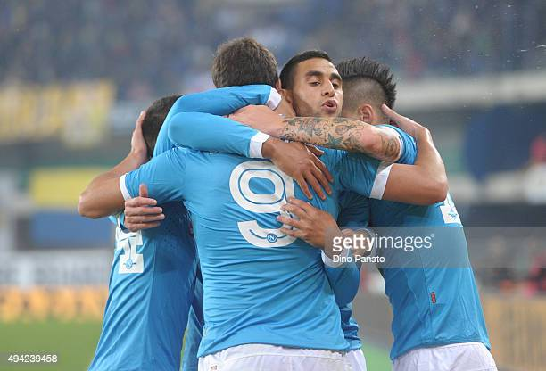 Gonzalo Higuain of SSC Napoli is mobbed by team mates after scoring his opening goal during the Serie A match between AC Chievo Verona and SSC Napoli...