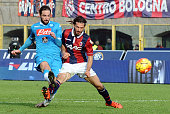 Gonzalo Higuain of SSC Napoli scores his team's second goal during the Serie A match between Bologna FC and SSC Napoli at Stadio Renato Dall'Ara on...