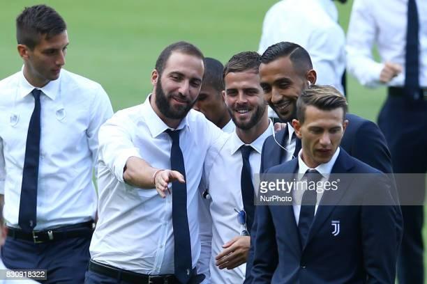 Gonzalo Higuain with Miralem Pjanic and Mehdi Benatia of Juventus during the Juventus Walk Around ahead of the Italian Supercup at Olimpico Stadium...