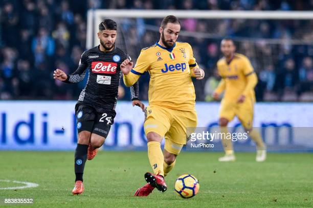 Gonzalo Higuan of Juventus and Lorenzo Insigne of Napoli during the Serie A match between Napoli and Juventus at San Paolo Stadium Naples Italy on 1...