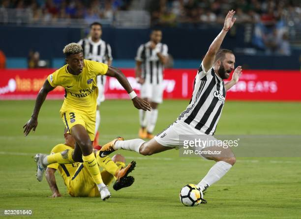Gonzalo Higuaín of Juventus takes a fall before Presnel Kimpembe of Paris SaintGermain during their International Champions Cup friendly match at...