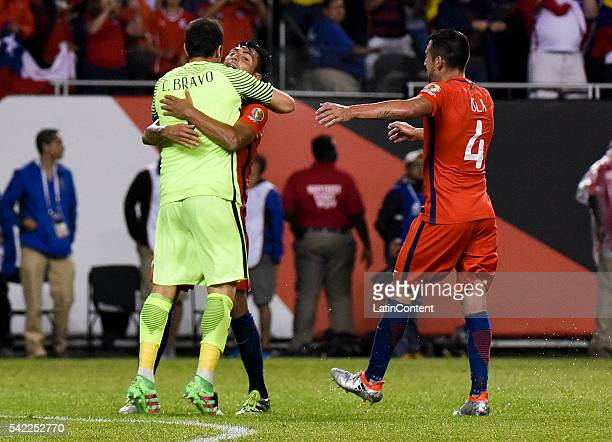 Gonzalo Jara Claudio Bravo and Mauricio Isla of Chile celebrate after winning the Semifinal match between Colombia and Chile at Soldier Field as part...