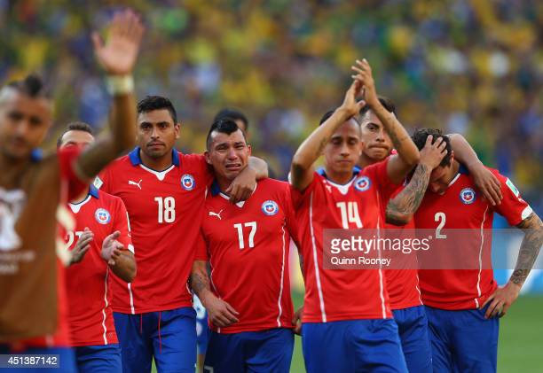 Gonzalo Jara Gary Medell Fabian Orellana Eduardo Vargas and Eugenio Mena of Chile react after being defeated by Brazil in a penalty shootout during...