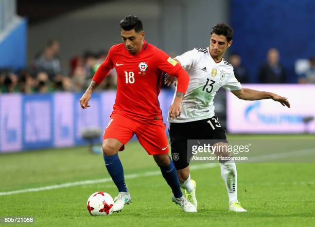 Gonzalo Jara of Chile and Lars Stindl of Germany battle for possession during the FIFA Confederations Cup Russia 2017 Final between Chile and Germany...