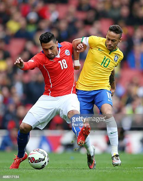 Gonzalo Jara of Chile and Neymar of Brazil comnpete for the ball during the international friendly match between Brazil and Chile at the Emirates...