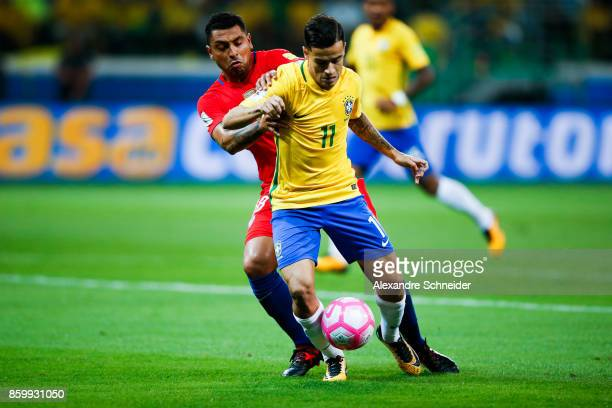 Gonzalo Jara of Chile and Philippe Coutinho of Brazil in action during the match between Brazil and Chile for the 2018 FIFA World Cup Russia...