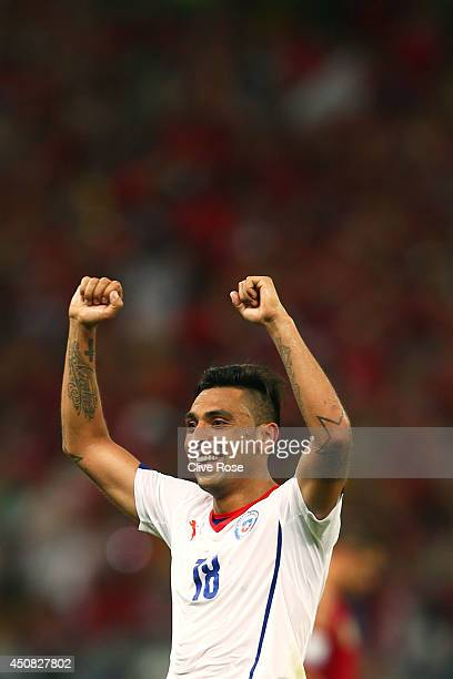 Gonzalo Jara of Chile celebrates after defeating Spain 20 during the 2014 FIFA World Cup Brazil Group B match between Spain and Chile at Maracana on...