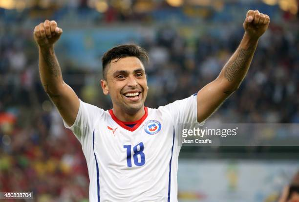 Gonzalo Jara of Chile celebrates the victory after the 2014 FIFA World Cup Brazil Group B match between Spain and Chile at Estadio Maracana on June...