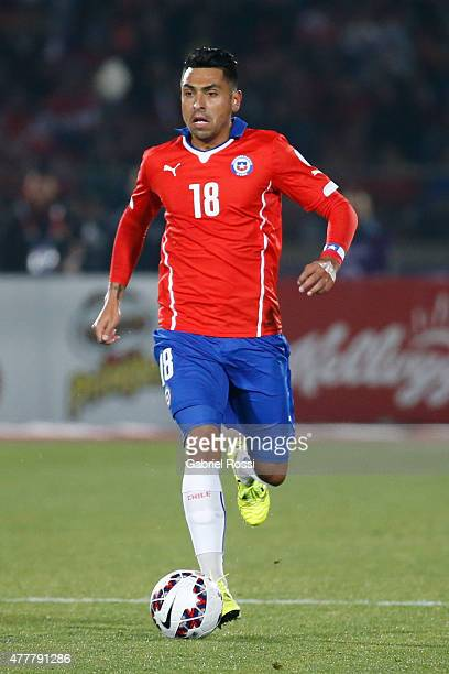 Gonzalo Jara of Chile drives the ball during the 2015 Copa America Chile Group A match between Chile and Bolivia at Nacional Stadium on June 19 2015...