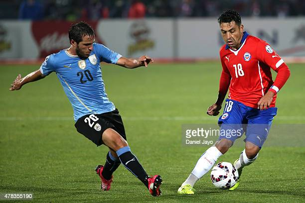 Gonzalo Jara of Chile fights for the ball with Alvaro Gonzalez of Uruguay during the 2015 Copa America Chile quarter final match between Chile and...