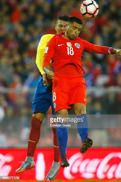 Gonzalo Jara of Chile fights for the ball with Carlos Garces of Ecuador during a match between Chile and Ecuador as part of FIFA 2018 World Cup...