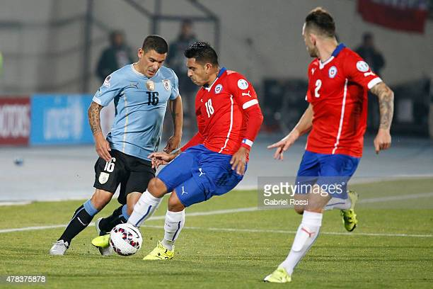 Gonzalo Jara of Chile fights for the ball with Maximiliano Pereira of Uruguay during the 2015 Copa America Chile quarter final match between Chile...