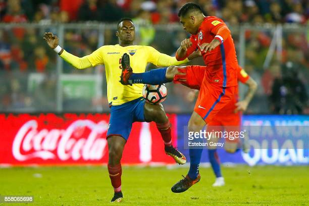 Gonzalo Jara of Chile fights for the ball with Renato Ibarra of Ecuador during a match between Chile and Ecuador as part of FIFA 2018 World Cup...