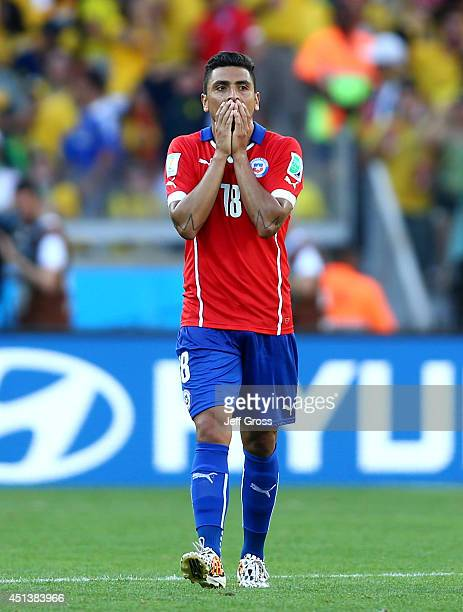 Gonzalo Jara of Chile reacts during the 2014 FIFA World Cup Brazil round of 16 match between Brazil and Chile at Estadio Mineirao on June 28 2014 in...